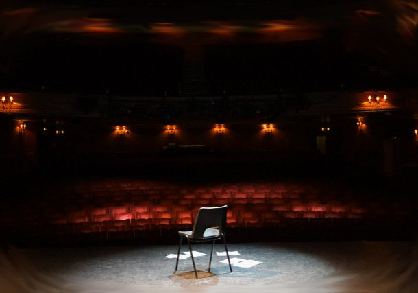 Chair and Papers in Empty Theater --- Image by © moodboard/Corbis